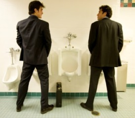 Two businessmen using the bathroom